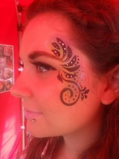 Sparkle Swirls face paint www.facebook.com/vizardfacebodyart