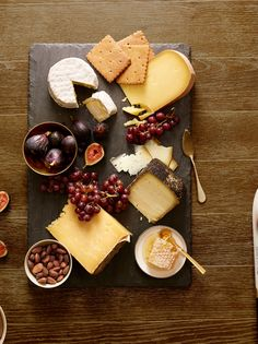 """""""Build a cheese board a few hours before the feast to quiet guests when they arrive. We recommend taking the cheese out of the refrigerator two hours before serving. Unwrap it and put it on a plate with an inverted bowl over it, which will protect the cheese as it comes to room temperature while still allowing it to breathe. Make two identical cheese boards so the first one can be replaced after the display gets attacked by the early birds. For 12 to 15 people, figure a pound of each cheese…"""