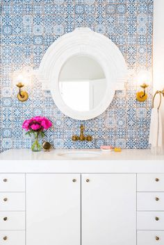 White and blue bathroom features a wall clad in blue Moroccan tiles, Fez Blue Vintage Moroccan Victorian Encaustic Effect Pattern Wall & Floor Tiles, lined with a white lacquered washstand adorned with aged brass knobs topped with thick white quartz and p Blue Moroccan Tile, Moroccan Bathroom, White Bathroom, Moroccan Rugs, Boho Bathroom, Moroccan Tile Backsplash, Feminine Bathroom, Rental Bathroom, Mosaic Bathroom
