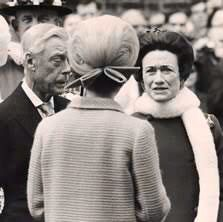 H.M. Queen Elizabeth II speaks with her uncle, H.R.H. Edward, Duke of Windsor. (Formally H.M. King Edward VIII), and his wife Wallis, Duchess of Windsor. (Formally Wallis Simpson). For the first time since his abdication in 1936 at an unveiling of a memorial plaque to their grandmother and mother respectively, H.M. Queen Mary, in 1967.