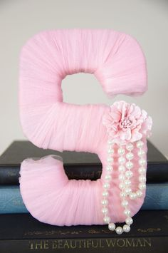 Tulle wrapped letter: get cardboard letter from michaels, wrap with tulle, hot glue a strand of pearls and a flower to match(: