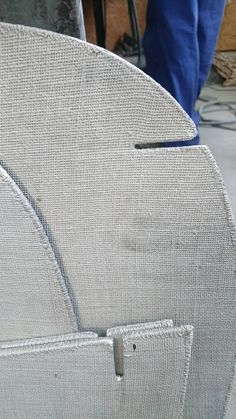 david de gourcuff and aki & arnaud cooren have fashioned a low chair using aluminum plates with the footprint of the fabric on both sides, finished with sewn edge.