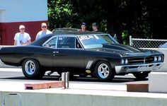 "Voted by JEGS fans at #15 is this sweet '67 Buick Gran Sport owned by Jessica Hicks. ""Built by my Dad, Jesse Hicks at Hicks Fabrication.455 Buick motor. Drag car, but still has the original interior, not gutted out, and is still street legal when you change the slicks to street tires. Was still tagged and insured until a few years ago. Beautiful and not a common car to drive. "" Very Cool!"