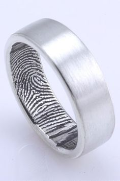Her fingerprint in the inside of his ring, and his on the inside of hers! So sweet!