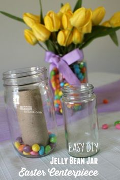 take a look at this super easy Jelly Bean Jar DIY Easter Centerpiece. Your Easter table decorations are set. The secret is in using a repurposed jar and a toilet paper tube! I love recycling in DIY decor projects! Jelly Bean Jar, Jelly Beans, Mason Jar Crafts, Mason Jar Diy, Easter Table Decorations, Easter Centerpiece, Easter Flower Arrangements, Easter Flowers, Centerpiece Ideas