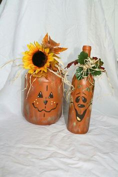 Cute idea.  Hand painted pumpkin bottles.  Sorry - there are no instructions, but you could easily wing these with some acrylic paints.