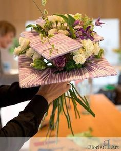 Unusual modern contemporary bridal bouquet in shades of soft purple and cream with delicate clematis and roses- by Andrey Kostin http://floristiqart.com/en