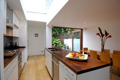 Kitchen extension + glass roof incorporating wood