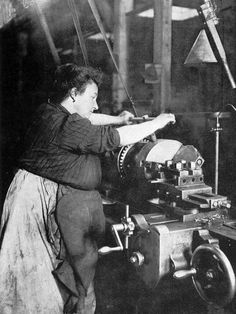 A French woman at an industrial lathe. WW I.  L'Illustration