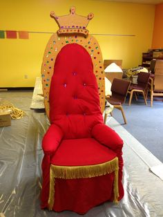 throne:  We used a red flat sheet as the fabric that was purchased at a thrift shop.  The only foam is the back.  We also used a mattress pad to fluff out the arms some and to make the transition from the chair to the back.