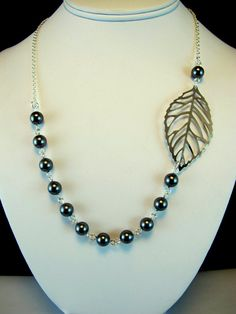 Asymmetrical Pearl and Leaf Necklace by byBrendaElaine on Etsy, $23.00