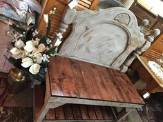 Repurposed wood into a bench . Amazing. Liza Jane.  Main St . Cowpens SC 2/2016. They used an old full size bed headboard, palate boards. I think the bottom frame was only 2 by 4 or could have been iron railing.