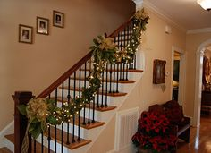 I love this staircase, decorated for Christmas.