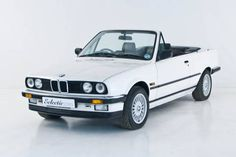 BMW E30 325. Wanted one since I was a teen. With wipers on headlights please.