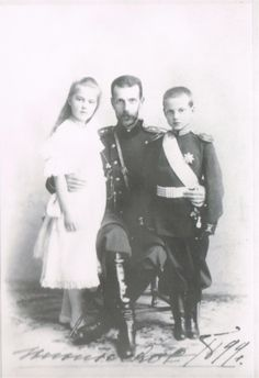Grand Duke Sergei with his Maria and Dmitri. The Duke who never had children of his own, was devoted to them.