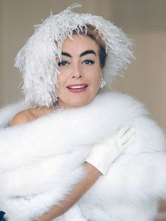Joan Crawford- no matter what role she is in..she's a knockout in both looks and her acting style. You can't go wrong with Joan! xoR