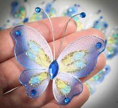 not the image but the concept that occurred when seeing the image: create a wire shape, full with crochet, and bling er up! Diy Butterfly Decorations, Butterfly Crafts, Butterfly Jewelry, Butterfly Art, Nylon Flowers, Diy Flowers, Fabric Flowers, Nylons, Nylon Crafts