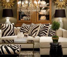 Animal print cushions on sofa - houses come inside ....