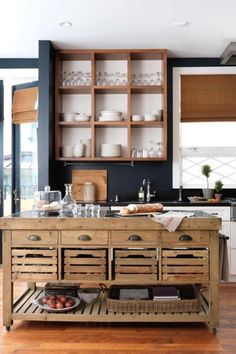 Loving the dark walls and rustic island in this kitchen! Very different but looks fabulous.
