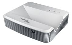 """Optoma EH320UST 1080p Ultra Short Throw Projector Bright projection – 4000 ANSI lumens Full HD 1080p resolution, 20,000:1 contrast ratio 2x HDMI input and 16W audio Crestron RoomView® – RJ45 control and monitoring Optoma's 1080p ultra short throw projector, the EH320UST, is perfect for businesses, schools and colleges. It is bright (4,000 lumens) and a throw ratio of 0.25:1 means that it can project a 100"""" image from just 55cm away. And having the projector installed so close to the scree..."""