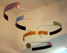 SURROUND Hanging Mobile  $625  Art by Joel Hotchkiss