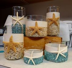 Vases adorned with seashells, sea glass, rope, and starfish #Beach #Nautical