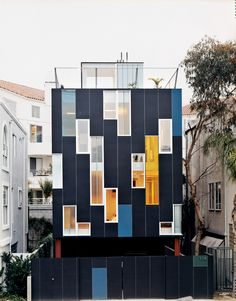 A dazzling display of colored windows wraps the custom furniture–filled Venice, California, home of architect Lorcan O'Herlihy.