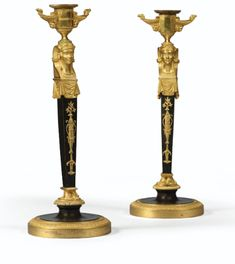 A PATINATED AND GILTBRONZE CANDLESTICKS, EMPIRE