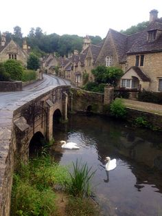 Castle Combe in Wiltshire, England in the rain, but it still looks beautiful, by Rob Little