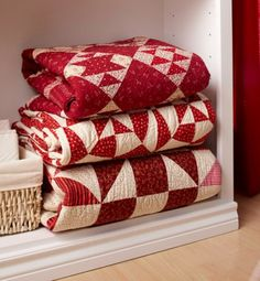 Have a stack of quilts at hand for easy grabs on a chilly night. Home For The Holidays | AllPeopleQuilt.com