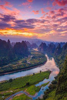 Watching the sunrise from the top of Mount Xiang Gong - Guilin, China  (by tian mai)