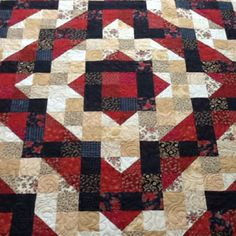 Like Marilyn Thieme's. What a beautiful quilt. I love the color scheme & the way the lights & darks look in the pattern.