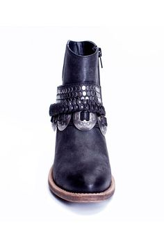This boot has rocker edge and serious style! These gorgeous HAWTHORNE black ankle boots by Matisse feature studded boot straps and a vintage inspired concho strap. The boots are equipped with a faux l