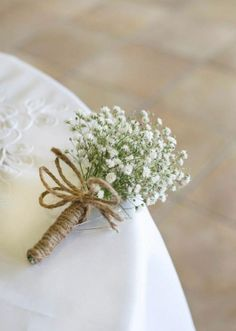 Corsages of gypsophila wrapped in burlap twine