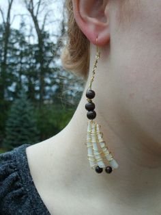 Gold Wire Wrapped Tusk Shell Earrings With Wooden Beads by BugTaxi, $30.00