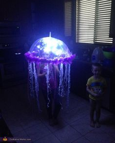 Jennifer: Serenity is 8 years old wearing her homemade jellyfish costume. Simple instructions: Clear kids umbrella LED battery powered lights xmas sparkling tubing streamers ribbon feather boa Add your batteries to...