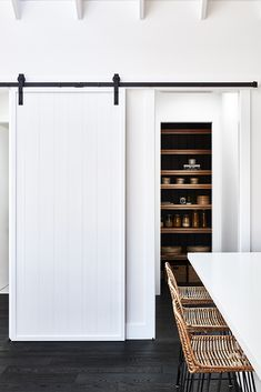 Kitchen Decor Black and White Kitchen Pantry with Natural Accents / AdoreMag - With the goal of creating a beach house to escape reality, Simone Mathews transformed her farmhouse into the ' Soul of Gerringong '. Home Renovation, Home Remodeling, Barn Door Pantry, Sliding Pantry Doors, Garage Doors, Kitchen Doors, Kitchen Pantry, Kitchen Cabinets, Kitchen Reno