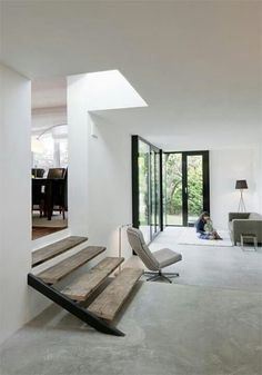 This is the exact kind of flooring we want!!! LIGHT CEMENT FLOORS- LIGHT WOOD- WHITE WALLS