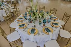 White, gold and blue wedding decor and floral set up