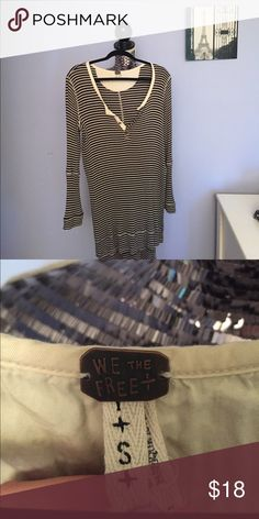 FREE PEOPLE Striped Henley Oversized striped henley Free People shirt, size small. Long length split between high low hem. Perfect condition. Free People Tops Tees - Long Sleeve