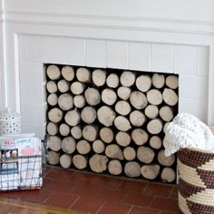 Make a faux log stock insert to cover an unsightly fireplace.