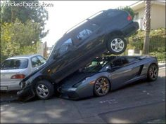 This accident happened as part of a parking dispute. The Saab ended up on top of the Lambo.