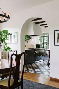 black cabinets, tile floor, white walls