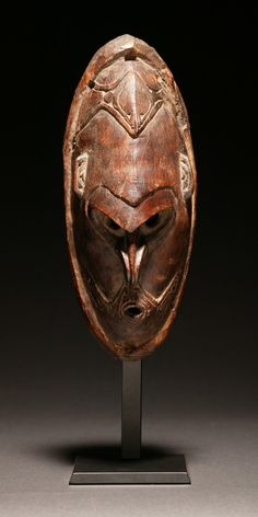 A very strong and powerful mask from the Murik Lakes Area near the mouth of the Sepik River. The eyes are piercing, the septum pierced, and the forehead juts far forward. The hard wood has a good dark patina from age and use. Late 19th or early 20th century, New Guinea.