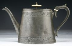 19th century English pewter teapot ... tapering oval body with engraved border, ivory knob and seperator on handle, marked 'Holland & Brangwin Hackney' on base, UK?