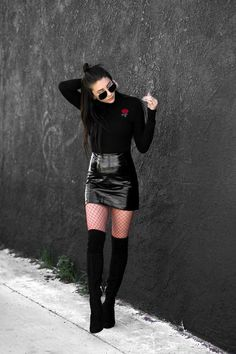 Black PVC mini skirt, long-sleeved sweater, fishnet tights and over-the-knee boots.. DIY the look yourself: