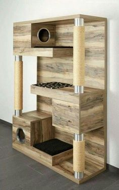 Cats Toys Ideas - If there was a cat tower that could do it all while looking ultra hip in your home – surely it has to be this! The Catframe combines a contemporary wood cat tree, sisal rope scratching posts,… - Ideal toys for small cats Diy Cat Tree, Cool Cat Trees, Wood Cat, Wooden Cat Tree, Wooden Cat House, Wood Tree, Pallet Cabinet, Cat Towers, Ideal Toys