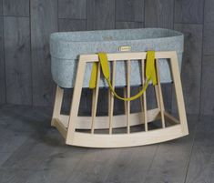 Rock baby off to sleep in our moses basket rocker shown here with the Mokee Nest.- Simple, fresh design to suit any room - Fixed height makes it perfect for placing beside your bed - Gentle rocking motion that lets your baby drift off to sleep - Perfect for use from birth until your child can sit up or kneel The Wool Mokee Nest is sold separately and comes in a variety of different colours. Visit the Mokee website for more detailsThe rocker is made out of solid beech and gently rocks…