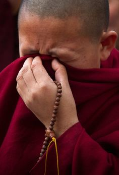 A Tibetan Buddhist nun cried during a vigil for Jamphel Yeshi in Dharamsala, India, on Monday, 3/26/2012