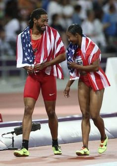 USA's Jason Richardson and Carmelita Jeter joke around after finishing their victory lap at Olympic Stadium during the London 2012 Olympics on Wednesday, August 8, 2012 in London. Richardson won silver in the men's 110 meter hurdles and Jeter took bronze in the 200 meter run.
